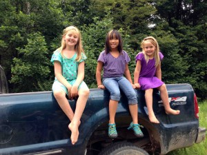 Back home... country girls on a pickup truck