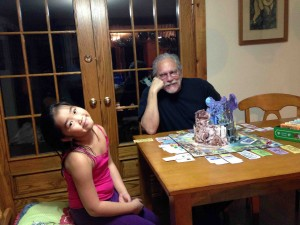 Izze and Dad at the 75th Anniversary Wizard Of Oz Monopoly Set