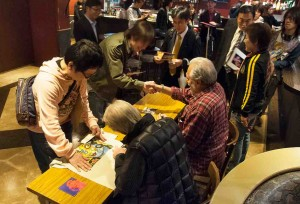 Signing a few items for our Japanese friends