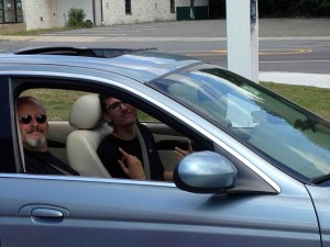 Phil and Zach in the Jaguar