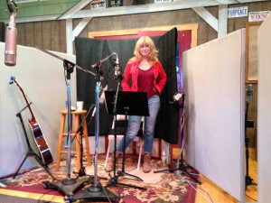 Teresa gets ready to sing and make me sound good!