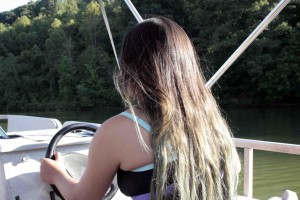 Izze drives the boat