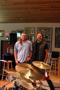 Myron and Justin bordered by cymbals