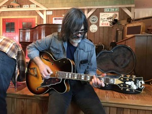 Larry Campbell tries out my new D'Angelico while the folks gather for orientation