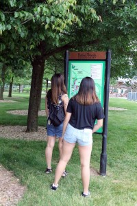 Izze and Vanessa look at the Woodstock signboard