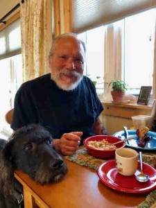 A man and his dog at birthday breakfast